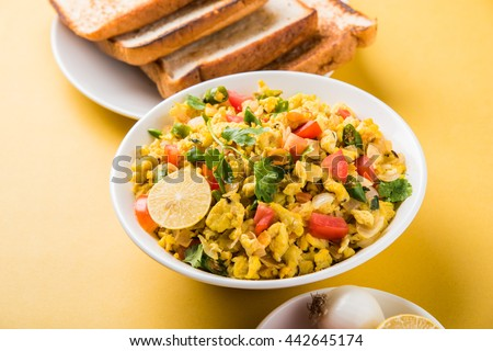 Masala Anda Bhurji or egg bhurji or Spicy scrambled eggs with roasted bread slices and salade