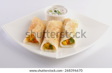 Masala Dosa, Dosa, South Indian snack, India,Dosa and Coconut Chutney  - stock photo
