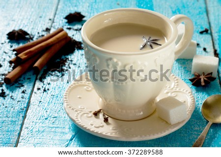 Masala spices. Cinnamon, cardamom, ginger, cloves, star anise, black pepper, black tea. - stock photo