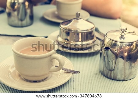 Masala tea set. Table with traditional tea setting.