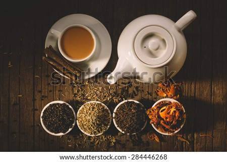 Masala tea with spices.National indian traditional beverage with tea, milk and spices. - stock photo