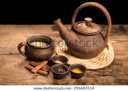 Masala tea with spices on dark wooden table