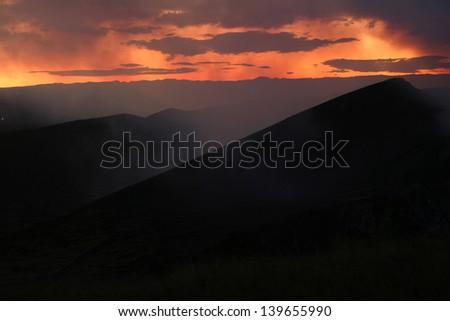 Masaya Volcano in Nicaragua. Taken at dusk and showing sulfurous smoke. - stock photo