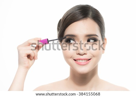 Mascara Applying. Long Lashes closeup. Mascara Brush. Eyelashes extensions. Makeup for Brown Eyes. Eye Make up Apply - stock photo