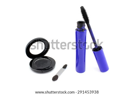 Mascara in blue tube and black shade - stock photo