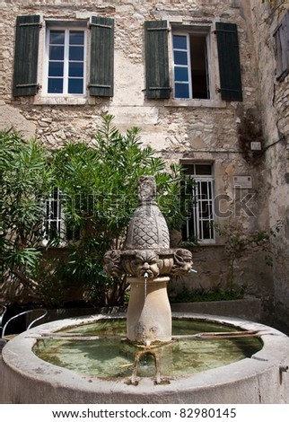 Mascarons fountain in the south of France , Provence - stock photo