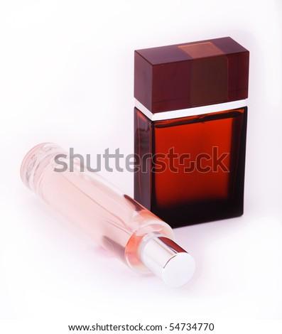 Masculine and feminine perfume bottles - stock photo