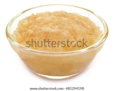 Mashed onion in a bowl over white background