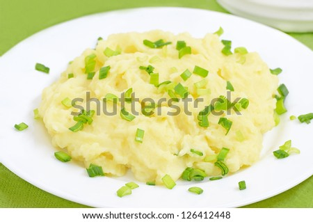Mashed potatoes on a white plate on the table - stock photo