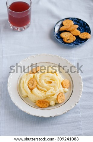 Mashed potatoes with croutons and juice homemade food - stock photo