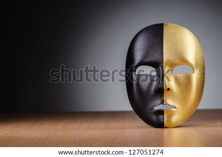 Mask against the dark background - stock photo