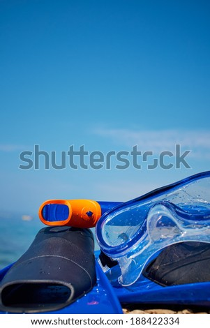 Mask and flippers on the beach  - stock photo