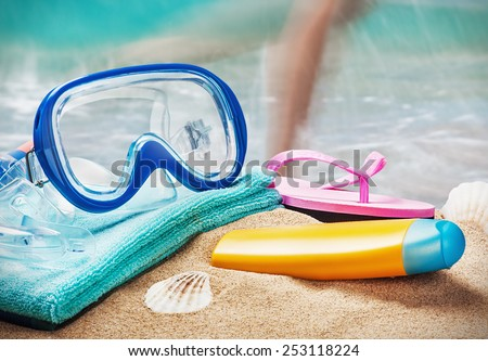 mask and snorkel to swim at the beach - stock photo