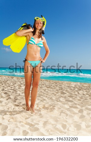Mask fins and snorkel fun - stock photo