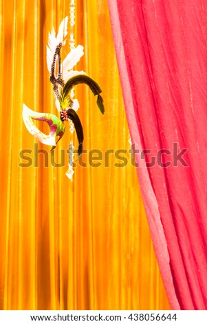 Mask floating on stage and gold curtain background and copy space./ Classical mask  floating on stage of life. - stock photo