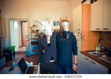 mask rabbit and horse couple in love at home