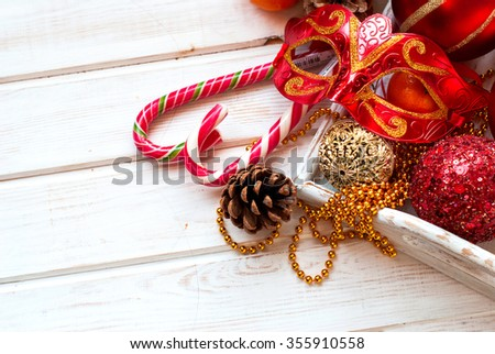 mask, red and gold Christmas balls, beads, cones, Christmas decorations