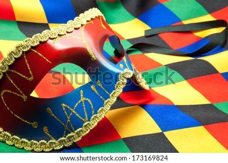 mask Venetian on a harlequin costume - stock photo