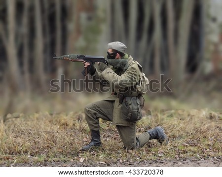 Masked airsoft player, who plays for Russian side of the army, old time scenery, blurred blackground - stock photo
