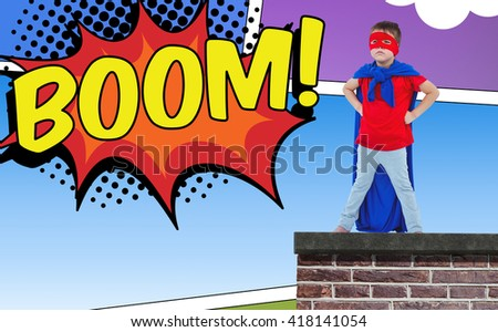 Masked boy pretending to be superhero against the word boom - stock photo