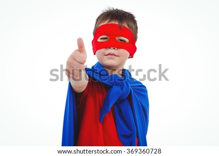 Masked boy showing thumb up pretending to be superhero on white screen - stock photo
