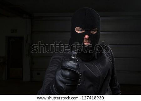 masked criminal holding knife - stock photo