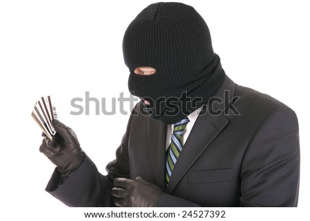Masked criminal stealing credit cards - isolated over the white background - stock photo
