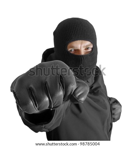 Masked criminal with clenched fist, isolated on white - stock photo