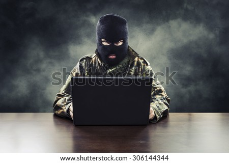 Masked cyber terrorist in military uniform hacking army intelligence - stock photo