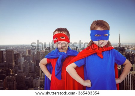 Masked kids pretending to be superheroes against new york skyline - stock photo