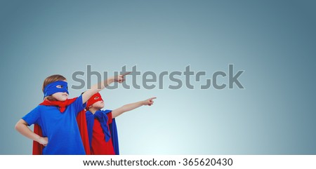 Masked kids pretending to be superheroes against purple vignette - stock photo