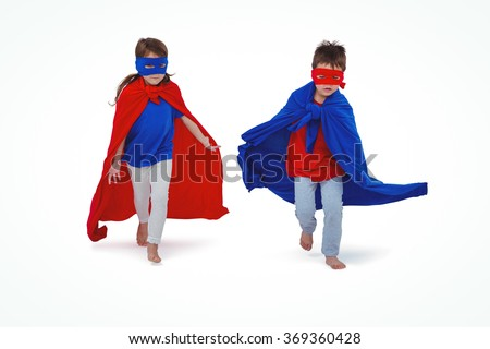 Masked kids running pretending to be superheroes on white screen - stock photo