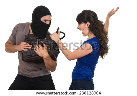 masked male thief fighting beautiful young girl with hand bag isolated on white - stock photo