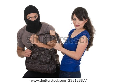 masked male thief robbing beautiful young girl with hand bag isolated on white