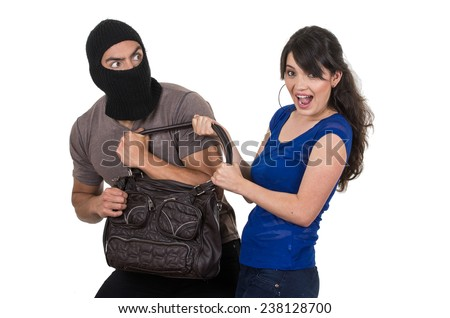 masked male thief robbing beautiful young scared girl with hand bag isolated on white - stock photo