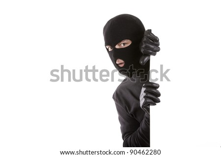 masked man appearing on one side with an expression of surprise - stock photo