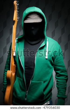 Masked Man playing the guitar