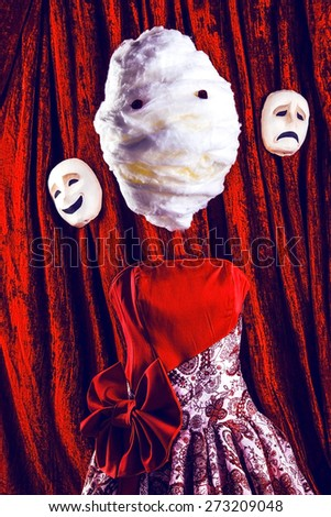 masks and red dress with bow against circus background - stock photo