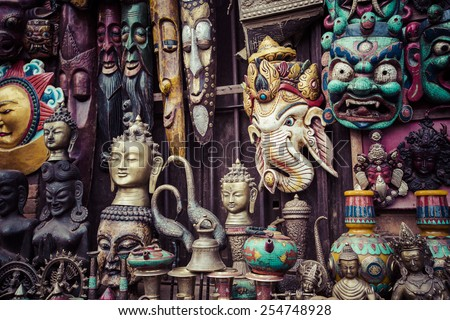Masks, dolls and souvenirs in street shop at Durbar Square in Kathmandu, Nepal. - stock photo