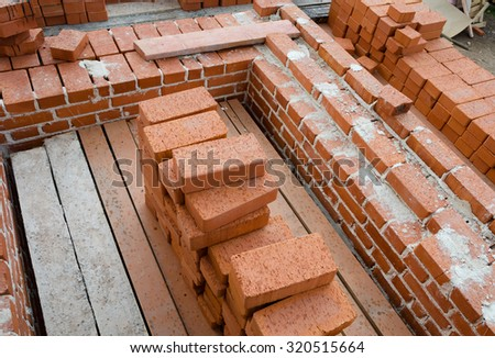 Mason bricklaying background with clay brick blocks - stock photo