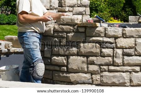 Mason building stone wall - stock photo
