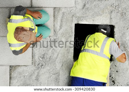 mason construction workers checking  the water and sewer  pipes  in the street city  - stock photo