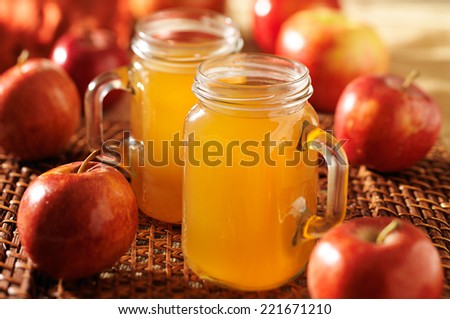 mason jars filled with hot apple cider - stock photo