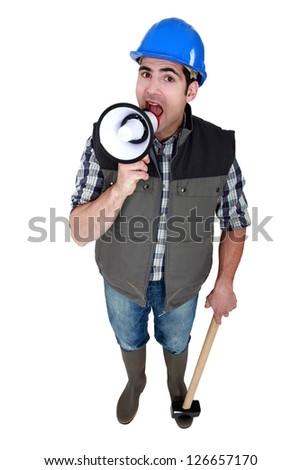 Mason shouting through megaphone - stock photo