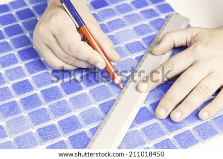 Mason tiles measuring rule, labor and industry - stock photo