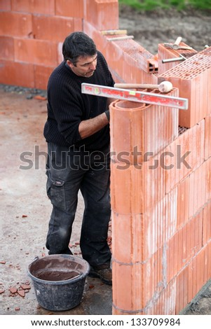 Mason working on site alone - stock photo