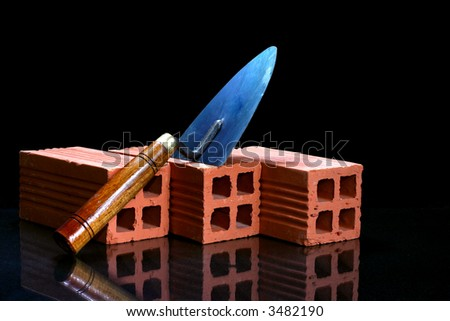 masonry construction with bricks and trowel