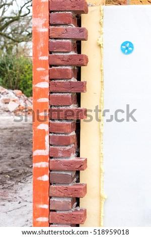 masonry wall with cavity wall insulation of new house