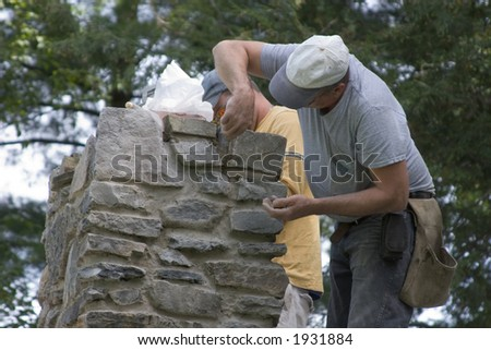 Masons Building a Stone Chimney