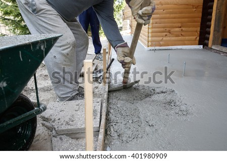 Masons filling wood form shovel concrete stock photo 100 legal masons filling wood form with a shovel of concrete mix for floor base in front of solutioingenieria Gallery
